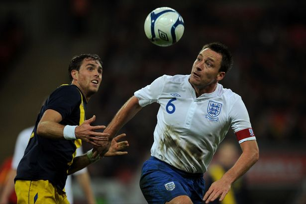The last of a noble lineage: John Terry heading a football